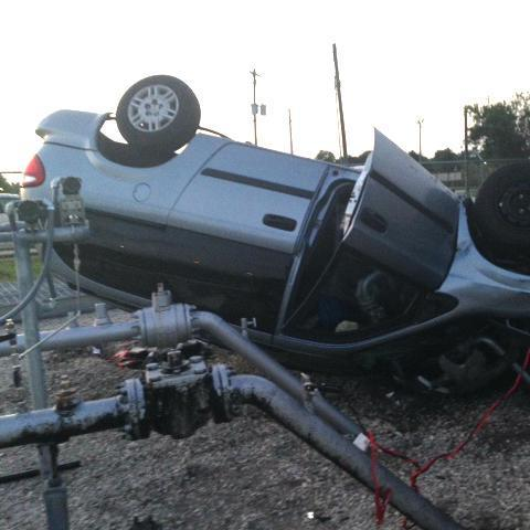 A 2005 Dodge minivan went airborne over an 8-foot security fence and landed upside down on top of a 6-inch steel gas pipeline Sunday at the Florida City Gas regulator station in Port St. Lucie. The accident left 6,000 city customers without natural gas in their homes and businesses. (Photo provided by Florida City Gas)